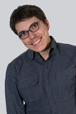 Cheerful young man in glasses Stock Photo