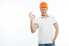 Cheerful young man with hardhat is expressing Royalty Free Stock Photo