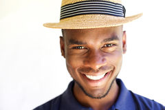 Cheerful young man in hat Stock Photos