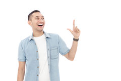 Cheerful young man having an idea while pointing upwards Stock Images