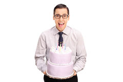 Cheerful young man holding a birthday cake Stock Photo