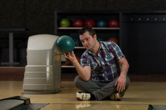 Cheerful Young Man Holding Bowling Ball Stock Photography