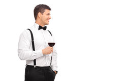 Cheerful young man holding a glass of red wine Stock Photography