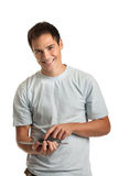Cheerful Young Man Holding a Touch Pad Tablet PC Royalty Free Stock Photography