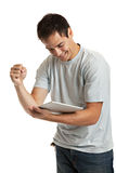 Cheerful Young Man Holding a Touch Pad Tablet PC Royalty Free Stock Photos