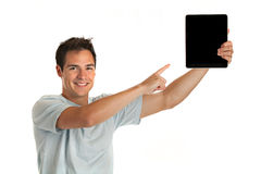 Cheerful Young Man Holding a Touch Pad Tablet PC Stock Photography