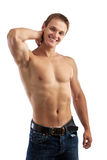 Cheerful young man in jeans with bare torso. Over white background Royalty Free Stock Photography