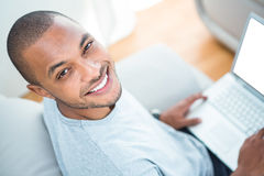 Cheerful young man with laptop Royalty Free Stock Photography