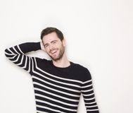 Cheerful young man laughing Stock Photo