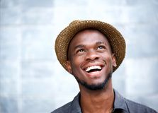 Cheerful young man laughing and looking up Stock Image