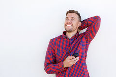 Cheerful young man laughing with mobile phone Royalty Free Stock Photo