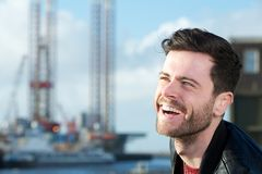 Cheerful young man laughing outdoors Stock Photo