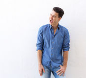 Cheerful young man laughing Royalty Free Stock Photos