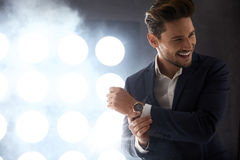 Cheerful young man in the night club Stock Photos