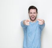 Cheerful young man pointing fingers Stock Photography