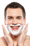 Cheerful young man is ready to shave Stock Photos