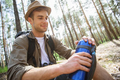 Cheerful young man resting in journey Royalty Free Stock Photos