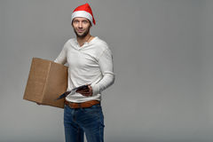 Cheerful young man in a Santa Hat Stock Photography