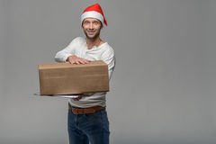 Cheerful young man in a Santa Hat Stock Photo