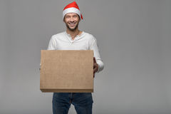 Cheerful young man in a Santa Hat Stock Photos