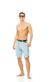 Cheerful young man in shorts Stock Image
