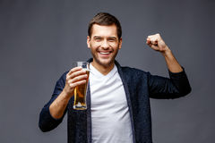 Cheerful young man in smart casual wear royalty free stock images