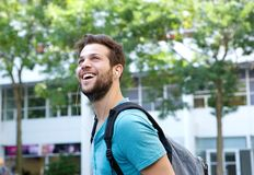 Cheerful young man smiling with bag Stock Photography