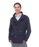 Cheerful young man smiling in blue jacket Royalty Free Stock Photography