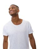 Cheerful young man smiling on isolated white background Royalty Free Stock Images