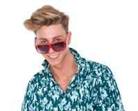 Cheerful young man smiling with sunglasses Royalty Free Stock Photos