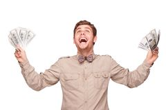 Cheerful young man with soft money Stock Photography