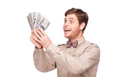 Cheerful young man with soft money Royalty Free Stock Images