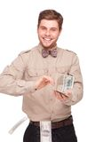 Cheerful young man with soft money Royalty Free Stock Photography