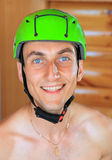 Cheerful young man in sports protective helmet Royalty Free Stock Photos