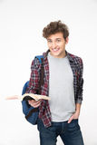 Cheerful young man standing with book Royalty Free Stock Photography