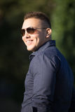 Cheerful young man in sunglasses Royalty Free Stock Photos