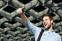 Cheerful young man taking selfie Royalty Free Stock Image