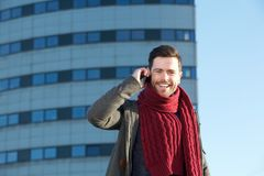 Cheerful young man talking on mobile phone in the city Royalty Free Stock Images