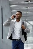 Cheerful young man talking on mobile phone. Close up portrait of a cheerful young man talking on mobile phone Royalty Free Stock Photography
