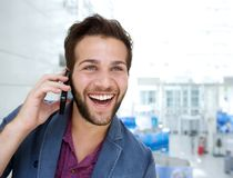 Cheerful young man talking on mobile phone Stock Image
