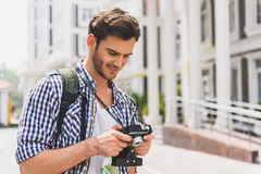 Cheerful young man watching done shots Royalty Free Stock Image