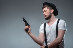 Cheerful young man with weapon and cap Stock Photos