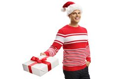 Cheerful young man wearing a santa claus hat and holding a present stock image