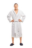 Cheerful young man in a white bathrobe Royalty Free Stock Images