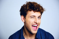 Cheerful young man winking Stock Photography