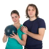 Cheerful young man and woman with bowling ball Royalty Free Stock Image