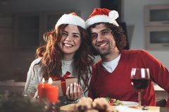 Cheerful young man and woman celebrating winter holiday stock photo