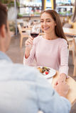 Cheerful young man and woman are resting in cafe Royalty Free Stock Images