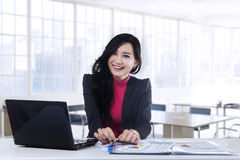 Cheerful young manager smiling at camera Royalty Free Stock Photos