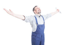 Cheerful young mechanic standing with arms wide open Royalty Free Stock Photography